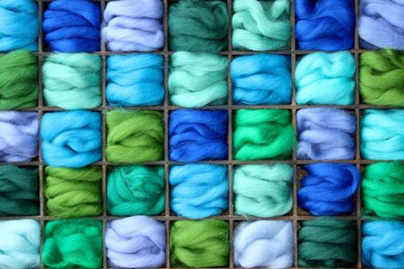 Collage of felting wool in a case