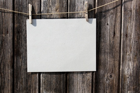 A blank piece of paper on a old wooden fence Stock Photo