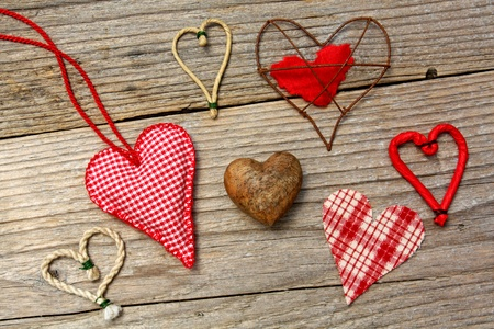 Different hearts on wooden background Stock Photo