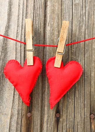 Handmade red hearts of scrim hanging on line Stock Photo - 9294188