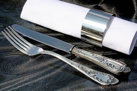Old  silver fork and knife with a napkin