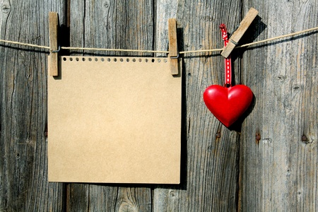 blank paper and red heart on line Stock Photo