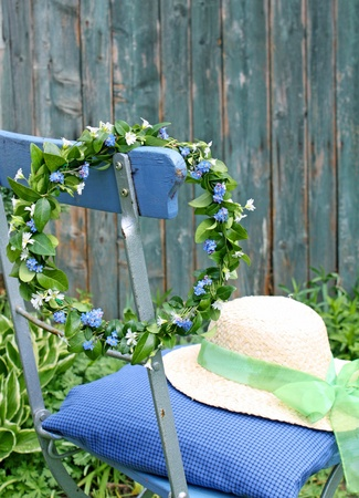 chaplet from forget-me-not flowers hanging on chair