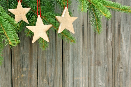 christmas ornaments hanging against a wooden wall Stock Photo