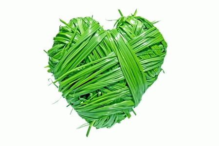 heart shaped from green grass on white background photo