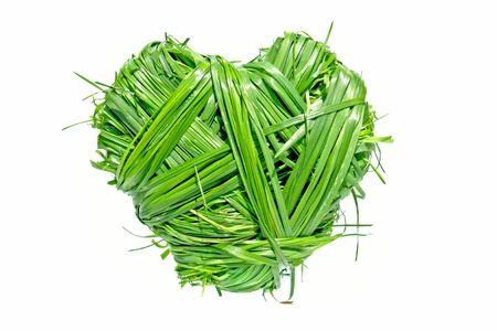 heart shaped from green grass on white background