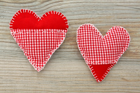 handmade hearts of scrim on wooden background photo
