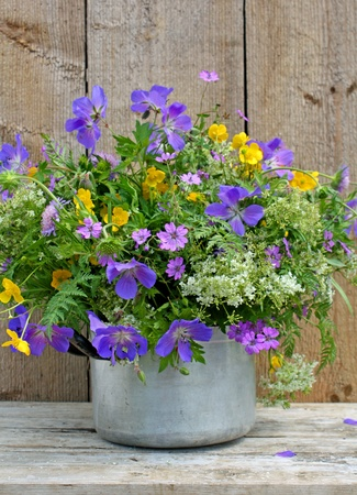 old pot with wild flowers Stock Photo