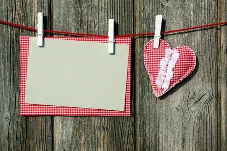 blank notepaper and heart from cotton