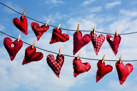 different red handmade love hearts on line photo