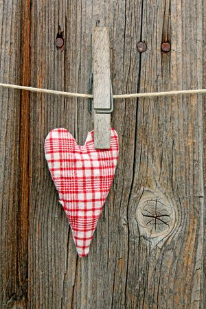 handmade little heart of scrim on line Stock Photo - 13403844