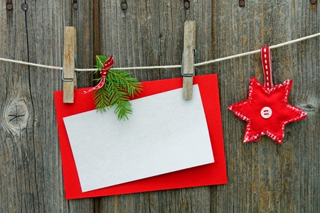 Christmas card and ornament hung on a string