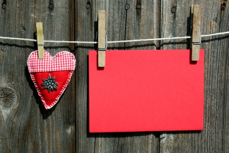 red advertising signs and handmade folk heart