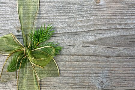green bow on wooden background photo