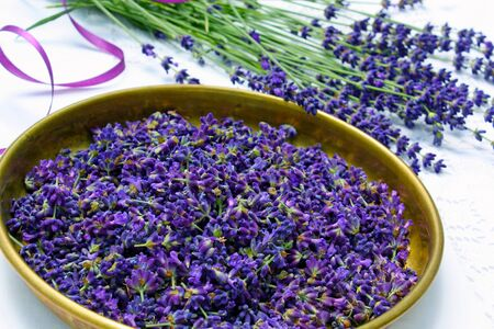lavender flowers in a bowl made of brass