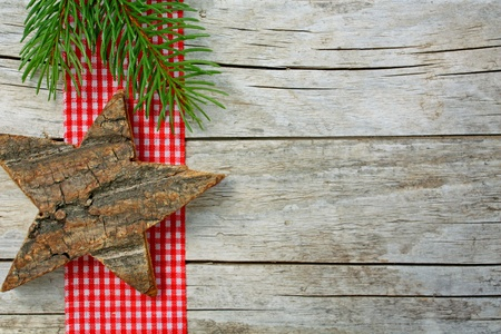 red  plaid: Christmas ornaments on weathered wood Stock Photo