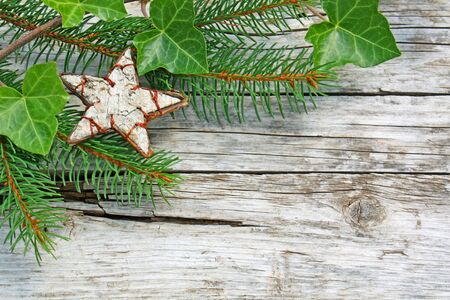 christmas ivy: Christmas ornaments on weathered wood Stock Photo
