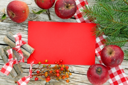 brushwood: card, apples, rose hips and brushwood tree  on a table Stock Photo
