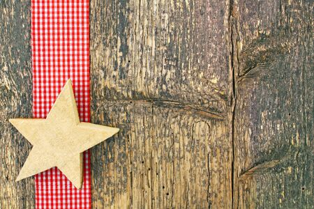 open country: christmas ornament on weathered board