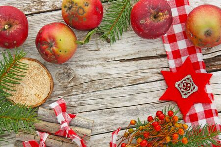 open country: Christmas decoration with apples on wood Stock Photo