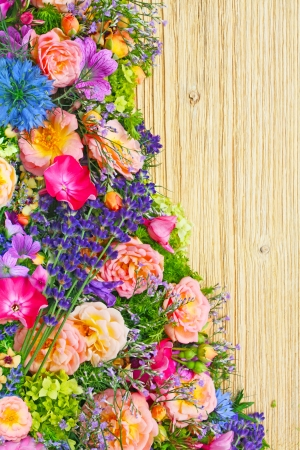 geranium: border made with fresh summer flowers on wooden background