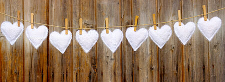 many white hand-stitched hearts made of cotton hanging on a leash