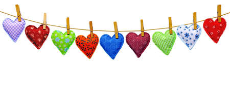 different, colorful, hand-stitched hearts of cotton cloth hanging on a leash Stock Photo