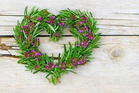 country living: heartshaped of fresh rosemary and thyme, as a symbol of health Stock Photo