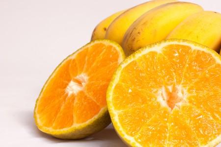 orange and banana on white background photo