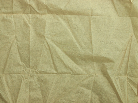 Crumpled brown paper napkin studio shot, patturn.