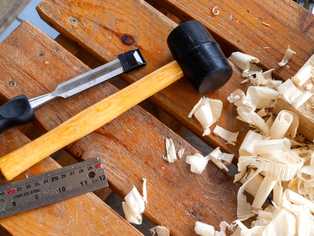 Carpenter work tools, rubber mallet, wood, chisel, ruler photo