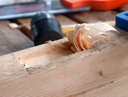 Carve pine wood to make motise joint. photo
