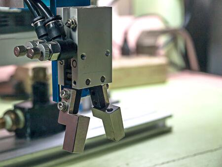 plc: Pneumatic robot handle grip, aluminum alloy material. Stock Photo