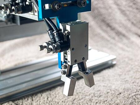 plc: Aluminum pneumatic  robot hand grip, close-up grip.