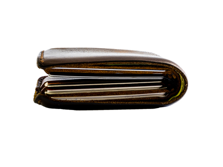 Le portefeuille d'épaisseur sur blanc isolé.