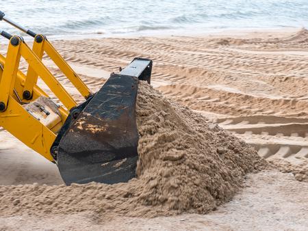 Closeup bulldozer at beach. Stok Fotoğraf