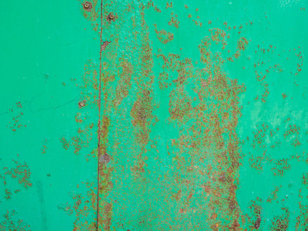Green metal plate with rust. Stock Photo