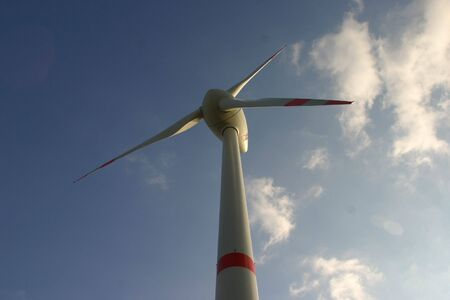 electricity tariff: Windmill before sky