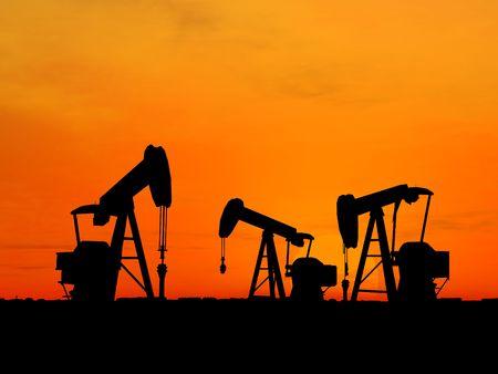 depletion: Three pumps over orange sky