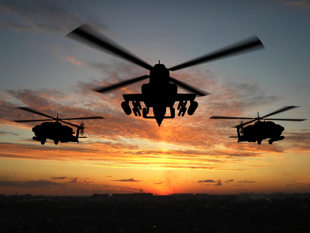 helicopters: Silhouette of helicopter over sunset Stock Photo