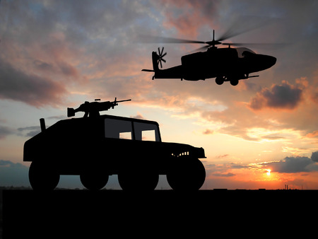Silhouette of truck over sunset with helicopter  photo