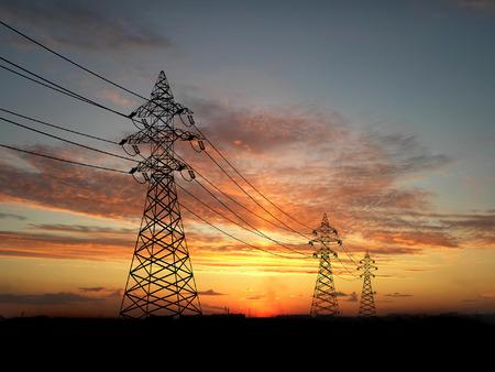 Electric powerlines over orange sky   photo
