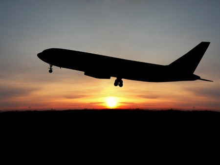 boeing: Silhouette of airplane over sunset