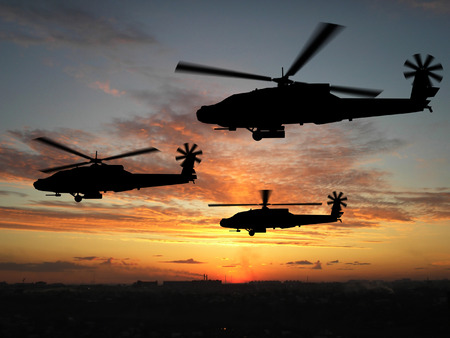 Silhouette of helicopters over sunset Stock Photo