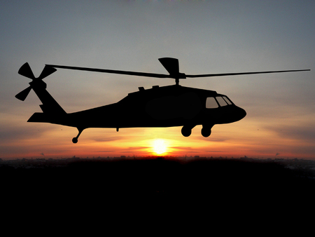 Silhouette of helicopter over sunset Stock Photo