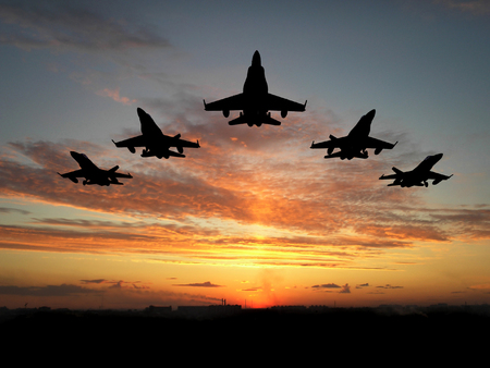 supersonic transport: Five bombers over orange sunset Stock Photo