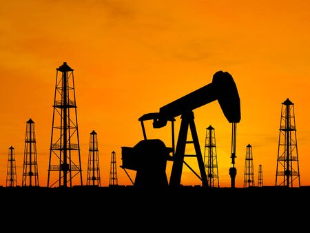 natural gas prices: Oil rig silhouettes over orange sky Stock Photo