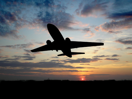 Silhouette of airplane over sunset Stock Photo - 1470960