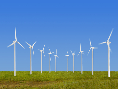 energies: Wind turbines on grass over blue sky