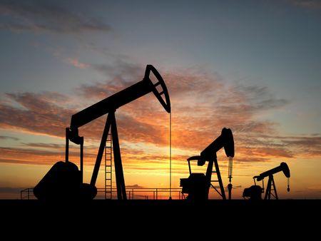 Three pumps over orange sky Stock Photo - 2030047